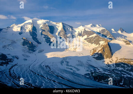 Aerial view on the snow covered mountains Piz Palü and Piz Bernina from Diavolezza - Stock Photo