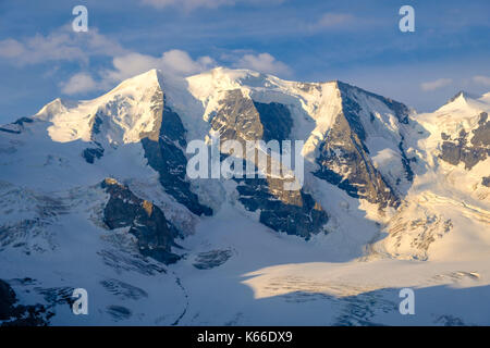 Aerial view on the snow covered summit of the mountain Piz Palü from Diavolezza - Stock Photo
