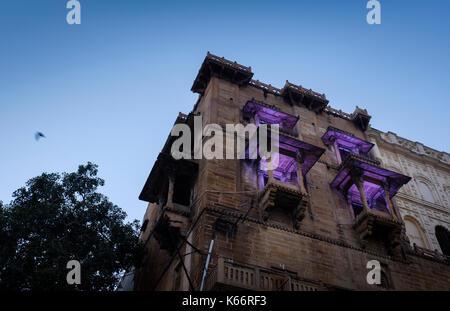 VARANASI, INDIA - CIRCA NOVEMBER 2016: Building over the Ganges river in Varanasi - Stock Photo