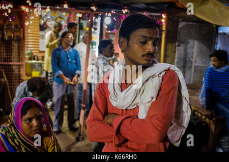 VARANASI, INDIA - CIRCA NOVEMBER 2016: People in the streets of Varanasi early morning. - Stock Photo