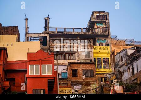 VARANASI, INDIA - CIRCA NOVEMBER 2016: Typical houses over the Ganges river in Varanasi - Stock Photo