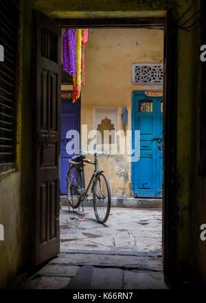VARANASI, INDIA - CIRCA NOVEMBER 2016: Typical house entrance in Old Varanasi. - Stock Photo