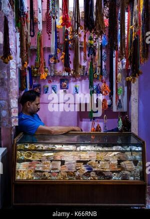 VARANASI, INDIA - CIRCA NOVEMBER 2016: Merchant in the streets of Old Varanasi. - Stock Photo