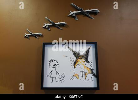 STANDALONE PHOTO Detail from an installation by artist Banksy, entitled Civilian Drone Strike, on display at the - Stock Photo