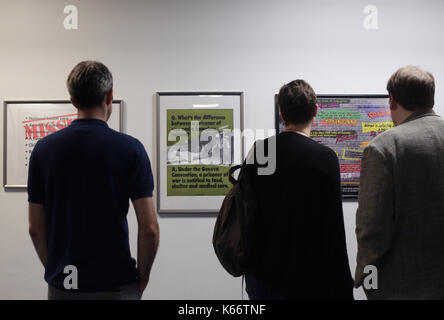 STANDALONE PHOTO Art by Guerrilla Girls on display at the Art the Arms Fair art exhibition - which has been set - Stock Photo