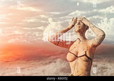 Frustrated cracking woman in drought - Stock Photo
