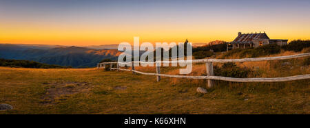 Sunset above Craigs Hut, built as the the set for Man from Snowy River movie in the Victorian Alps, Australia - Stock Photo