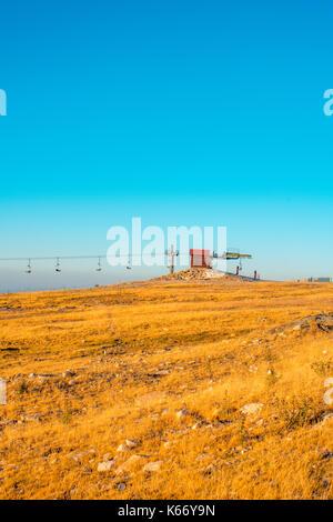 view of ski slope with ski leaft - Stock Photo