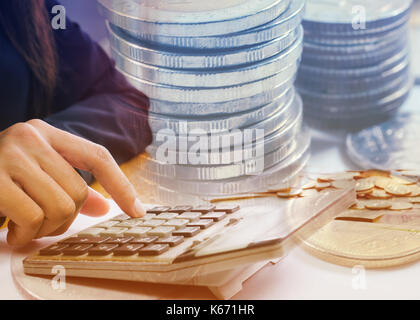 Double exposure female accountant making calculations. Savings, finances and economy concept - Stock Photo