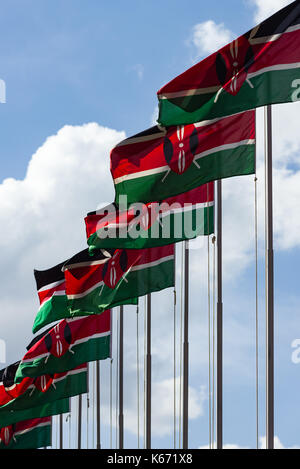 Kenyan flags on poles blowing in the wind on a sunny day, Nairobi, Kenya - Stock Photo
