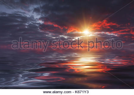 Reflection of a beautiful sunset sky in the water - Stock Photo