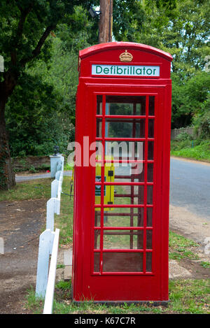 old fashioned red phonebooth in England - Stock Photo
