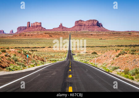 Road leading to Monument Valley, Utah, United States - Stock Photo