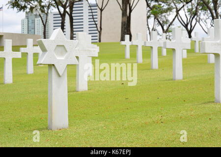 MANILA, PHILIPPINES - APRIL 1, 2016: Manila American Cemetery and Memorial. With 17,206 graves it is the largest - Stock Photo