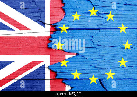 Brexit concept image: flags of the European Union (EU) and United Kingdom (UK) painted on a cracked broken wooden - Stock Photo