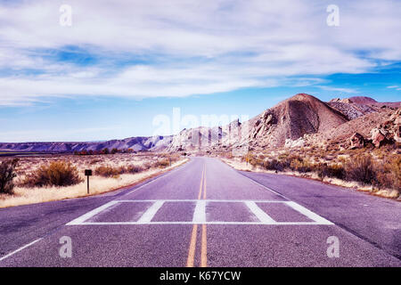 Vintage toned picture of a scenic deserted road, USA. - Stock Photo