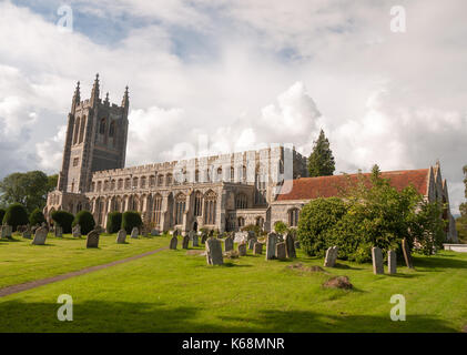 amazing full frontal summer view of old english church in long melford with cemetery in front; England; UK - Stock Photo