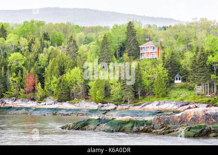 Port-au-Persil cityscape in Quebec, Canada Charlevoix region during stormy rainy rain day with Saint Lawrence river, - Stock Photo