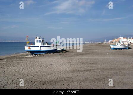 Fishing boats docked on the beach at San Miguel, San Miguel de Cabo de Gata, Almeria province, Spain - Stock Photo