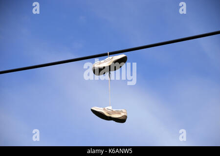 A Pair of Trainers Hanging from Electric Overhead Cable at the Rest and be Thankful in Glen Croe, Western Highlands, - Stock Photo