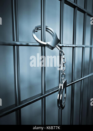 Handcuffs attached to metal prison bars.3D illustration. - Stock Photo