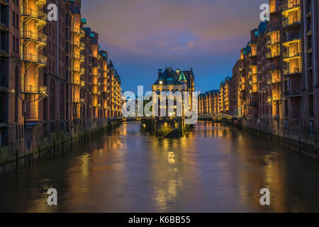 Water castle in old Speicherstadt or Warehouse district, Hamburg, Germany - Stock Photo