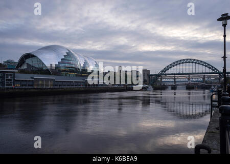 The Newcaste-Upon-Tyne/Gateshead quayside at dusk, showing the Sage and Tyne bridge - Stock Photo