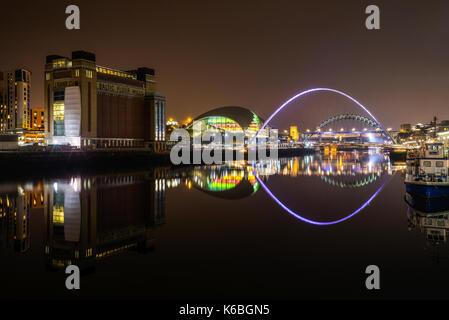 The Newcaste-Upon-Tyne/Gateshead quayside at night, showing the Baltic, Sage, Milennium and Tyne bridges - Stock Photo