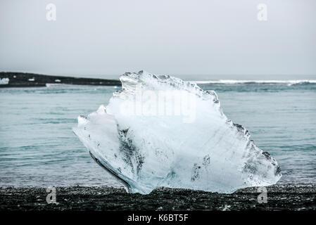 A piece of iceberg lying on the beach near Blue Lagoon Island. - Stock Photo