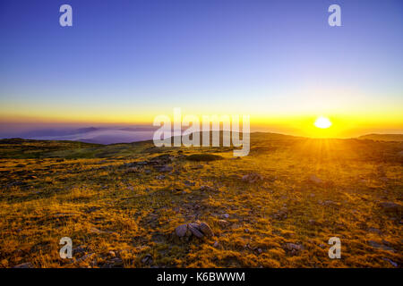 sunset on a summer day in the mountains - Stock Photo