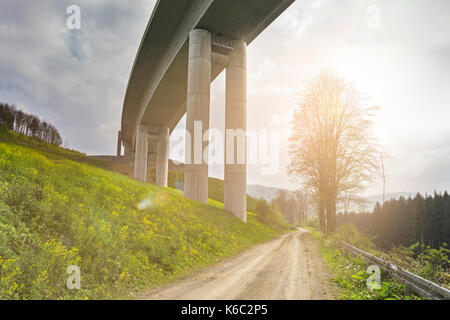 Construction of the highway valley bridge Nuttlar sunlight - Stock Photo