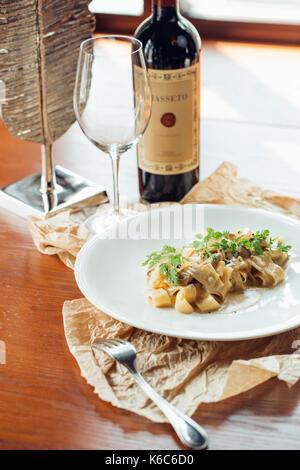 Fettuccine Alfredo with Zucchini, Bacon, Marjoram and Mint - Stock Photo