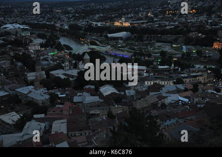 Tbilisi. View of the city and a monument to the mother of Georgia from the hill during the storm. - Stock Photo