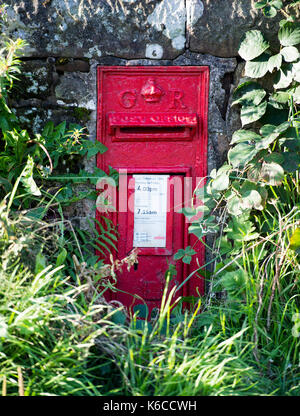 Wall Mounted Post Box with cypher GR for the reign of King George England, near Balfron Strirlingshire. - Stock Photo