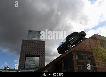 Frankfurt, Germany. 12th Sep, 2017. A VW-Pickup drives on the all-terrain course in front of the fair gatehouse - Stock Photo