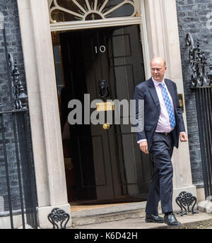 London, UK. 12th Sept, 2017. Chris Grayling, Transport Secretary leaves 10 Downing Street following a cabinet meeting - Stock Photo