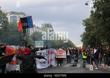 Paris, France. 12th Sep, 2017. Protester throws rock at police in paris Credit: Conall Kearney/Alamy Live News - Stock Photo