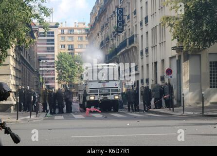 Paris, France. 12th Sep, 2017. Water cannon is deployed after clashes in Paris Credit: Conall Kearney/Alamy Live - Stock Photo