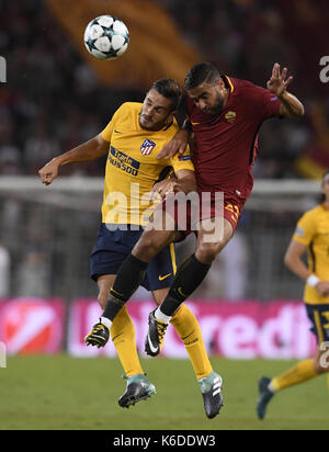Rome, Italy. 12th Sep, 2017. Atletico Madrid's Koke (L) competes with Roma's Gregoire Defrel during a UEFA Champions - Stock Photo