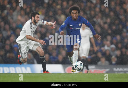 London, UK. 12th Sep, 2017. William (R) of Chelsea vies with Badavi Huseynov of Qarabag FK during their UEFA Champions - Stock Photo