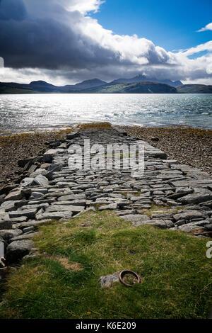 Stone jetty by Tongue Causeway, Scotland - Stock Photo