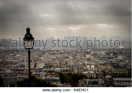 Paris, France, panorama in dramatic light seen from Montmartre with Notre Dame and Centre Pompidou visible and a - Stock Photo