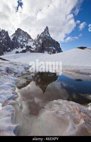 Mountain peak reflected in water, Cimon Della Pala, South Tyrol, Italy - Stock Photo