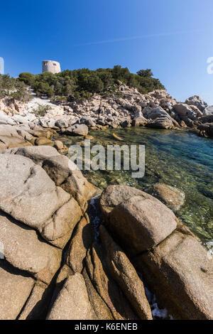 Cliffs and rocks frame the tower overlooking the turquoise sea Cala Pira Castiadas Cagliari Sardinia Italy Europe - Stock Photo