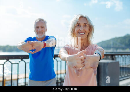 Upbeat senior couple working out in the streets - Stock Photo