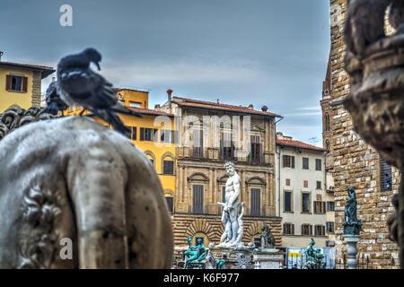 Lion statue in Piazza della Signoria seen from the back - Stock Photo