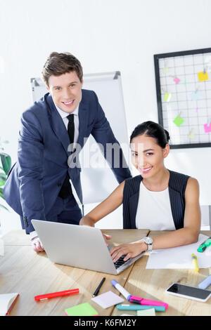 multiethnic business people working on laptop - Stock Photo