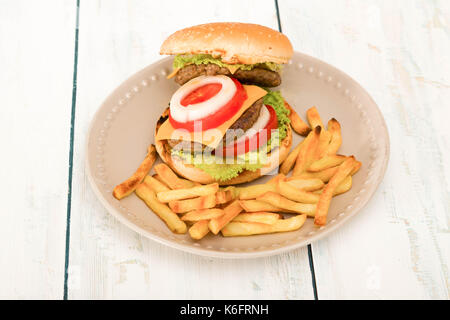 Homemade hamburger with fresh vegetables and french fries ,close-up - Stock Photo
