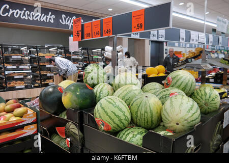 Watermelons on the fresh department of a Lidl supermarket. - Stock Photo