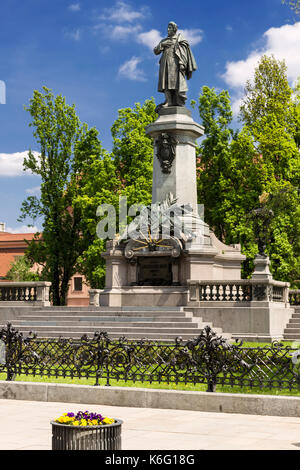 Sights of Poland. Monument of great Polish poet Adam Mickiewicz in Warsaw - Stock Photo